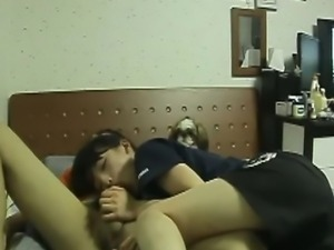 A Japanese guy sets up a hidden cam in his dorm room and fucks his cute...