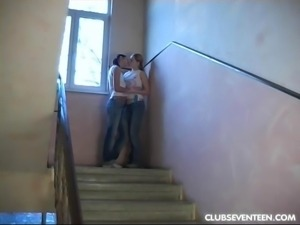 Gorgeous lesbians toying in a hallway