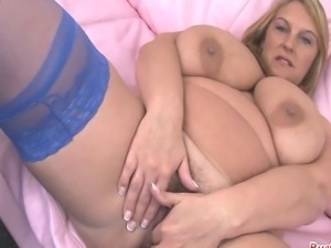 Big tits mature Carol Brown plays with her massive boobs then fucks her giant...