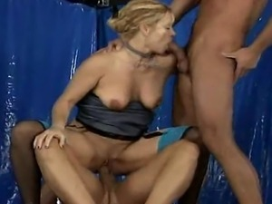 The old whore gets a double-penetration.