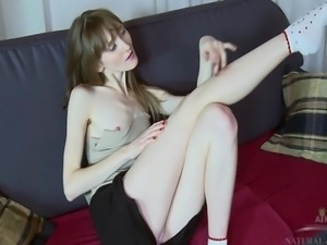 Vasilisa stretches out her long ermine body on the couch and fingers her...