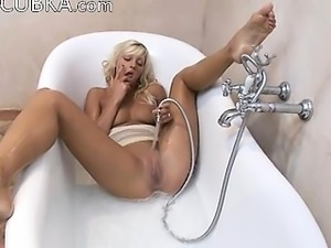 Busty blonde beauty teasing with shower