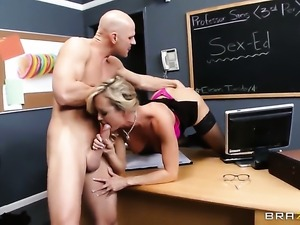 Brandi Love with gigantic hooters is one oral slut that gives Johnny Sinss...
