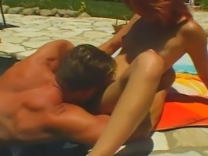 Redhead sweetie gets amazing outdoor poolside fuck