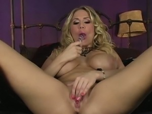 Alanah Rae plays with a glass dildo