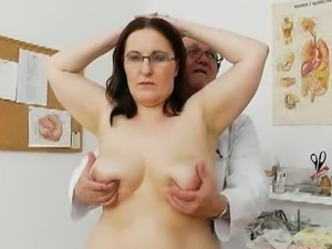Curvaceous Dorotha having an erotic pussy exam