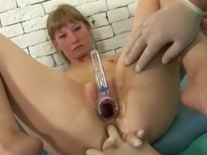Perverted doctor examines a redheaded's holes