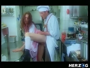 chef fucking a clothed lady in the kitchen