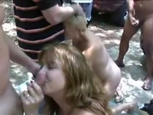 Two swinger sluts have an orgy in a park