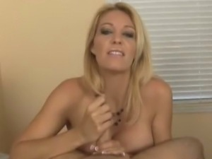 Busty milf Charlee Chase gives a slow handjob