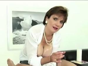 Masturbatrix rubs cock with massive tits