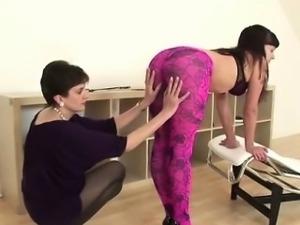 Lady Sonia spanks stockinged babe