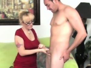 Handjob loving mature working his cock
