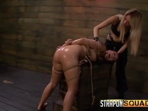 oiled asian gets a dildo shoved in her pussy