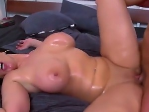 Oiled up MILF Sandra shows off her nice body as she gets her massive tits and...