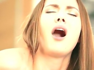 Connie Carter is one attractive European babe with long brown hair, big...