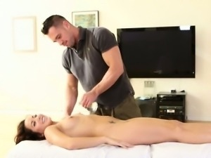 Gorgeous Brunette Getting Rubbed Down On Massage Table