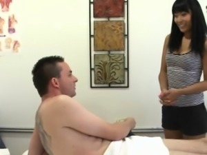 Petite asian masseuse sucking and tugging client