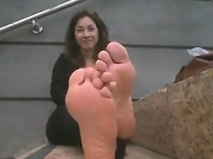 Cutie In Rubber Shoes Teases Her Feet