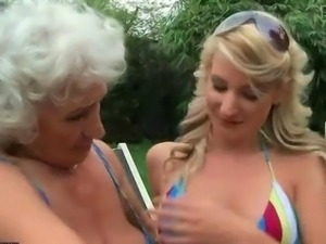 Granny fucks young girl with strapon outdoor