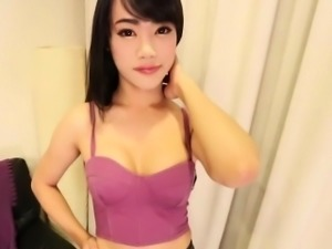 Young thai shemale beauty plays with her cock