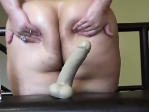 Attractive small bbw having a dildo caught in her butt