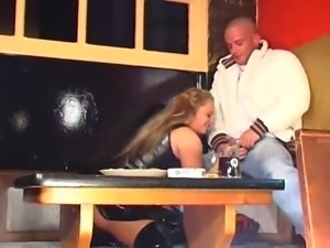 Latex blonde in thigh high boots is fucked on the table