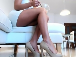 Elegant blonde girl shows off her sexy long legs and her di