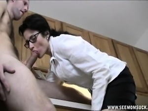 Wild brunette with glasses Tatiana gives a hot blowjob in the kitchen