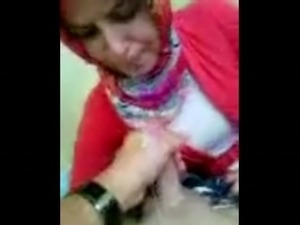 Turkish girl in Hijab blows and takes cum shot