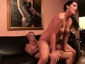 Stunning dark-haired babe enjoys getting fucked by this hot blonde
