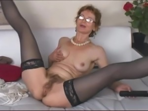 Older woman with hairy pussy