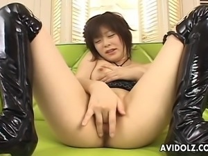 Asian bitch has a wank where she cums strong