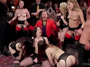 This is a birthday party of this guy in silk red gown in the middle. And all...