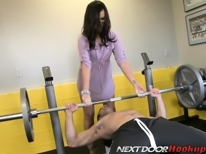 Slender brunette has a tattooed stud banging her wet pussy in the gym