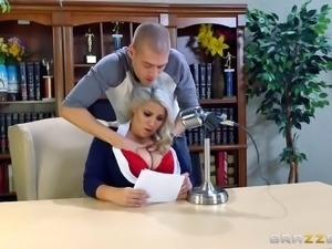 Nerdy blonde in a short skirt rides the hard schlong on the table