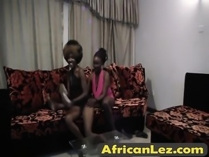 Two African Whores Sharing Big Dildo
