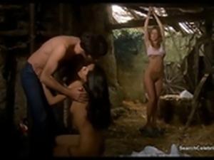 Laura Gemser and Monica Zanchi share a hard cock