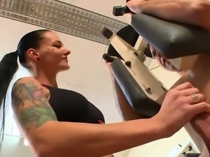 Busty raven haired fitness slut sucks her trainer off in the gym