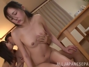 Tempting asian chick Momodani Erika and her girlfriend share a hard cock