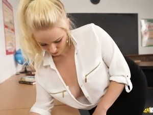 Stunning blonde chick Megan shows off her fine boobs