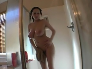 Attractive Chelsea puts her massive hooters on display in the shower