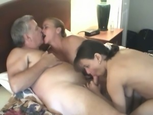 Fat dude enjoys fucking two amateur bitches in FFM scene