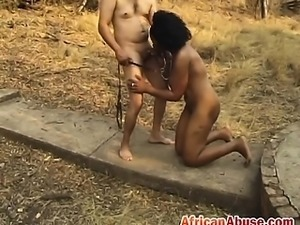 African slut sucks cock while being in chains