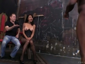 Exotic mistress Dana Vespoli in crotchless pantyhose and corset shows her...