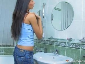 Gorgeous young beauty dildo masturbates in the bathroom
