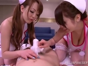 Two big-breasted Japanese nurses share a boner in FFM sex scene