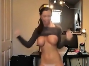 Teen with big tits dances in front of webcam