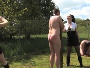 English femdoms punish submissive outdoors
