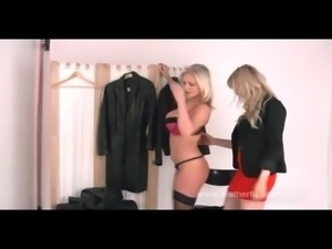 Hot blonde babes tease in leather and rub big tits together
